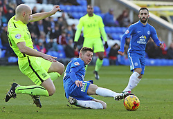 Harry Beautyman of Peterborough United tackles Southend United's Adam Barrett - Mandatory byline: Joe Dent/JMP - 16/01/2016 - FOOTBALL - ABAX Stadium - Peterborough, England - Peterborough United v Southend United - Sky Bet League One