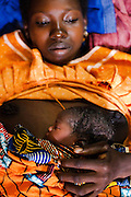 Mariatou Dansira, 24, lies skin to skin with her newborn girl at the Kita reference health center in the town of Kita, Mali on Friday August 27, 2010. Skin-to-skin contact is recommended as part of the Kangaroo mother care practice, a universally available and biologically sound method of care for all newborns, particularly important for premature or under weight babies.