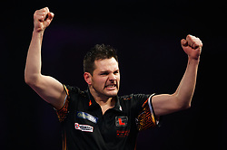 Toni Alcinas celebrates defeating Kevin Munch during day eleven of the William Hill World Darts Championship at Alexandra Palace, London.