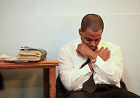 Cameron Bridgewater prays during a joint worship session between members of a Sephardic Jewish congregation and the African-American Christians at South Calvary Baptist Church in Indianapolis, Ind. A strong bond has formed between Jewish congregation that used to be in downtown Indianapolis and the African-American Christians who have subsequently moved into the neighborhood. .Chris Bergin/ For the New York Times
