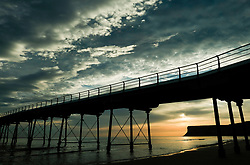© Licensed to London News Pictures. <br /> 28/08/2017<br /> SALTBURN-BY-THE-SEA, UK.  <br /> Clouds form over the pier and cliffs in Saltburn-by-the-Sea at sunrise on Bank Holiday Monday.<br />   <br /> Photo credit: Ian Forsyth/LNP