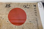 Tokyo, April 10 2014 - A Japanese flag on display inside the Yushukan, Yasukuni Shrine's war museum.
