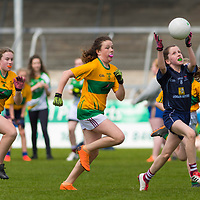 Lucy Power gathers the ball as Lauren Quinn tracks back.<br /> <br /> Division 1 between Barefield NS and Knockanean NS in the Clare Primary Schools Ladies Football Finals at Cusack Park, Ennis, Co. Clare