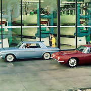 A 1964 Studebaker Daytona Hardtop and a 1964 Avanti are shown in this Studebaker factory publicity image.