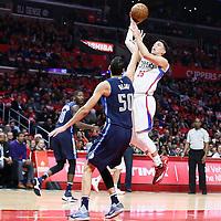 23 December 2016: LA Clippers guard Austin Rivers (25) takes a jump shot over Dallas Mavericks center Salah Mejri (50) during the Dallas Mavericks 90-88 victory over the LA Clippers, at the Staples Center, Los Angeles, California, USA.