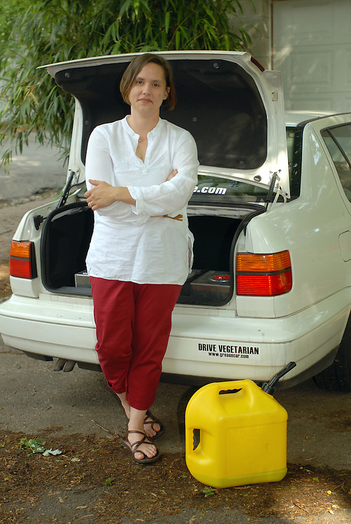 5/16/07 5:32:29 PM -- Louisville, KY, U.S.A..After converting her 1998 Diesel Volkswagen Jetta to a dual-fuel system, Maria Allison fills the 12.5 gallon tank in the trunk with discarded vegetable oil filtered in the garage...Photo by Brian  Bohannon , Freelance.