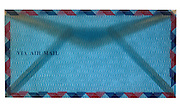 closed blue traditional standard air mail envelope front side