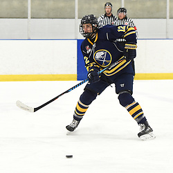 TORONTO, ON  - JAN 7,  2018: Ontario Junior Hockey League game between the Toronto Jr. Canadiens and the Buffalo Jr. Sabres, Ryan Sidorski #12 of the Buffalo Jr. Sabres passes the puck during the third period.<br /> (Photo by Andy Corneau / OJHL Images)