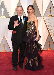 Oct. 10, 2017 -  (File Photo) - Movie producer Harvey Weinstein is being accused of sexual harassment allegations, which has led to him being fired. PICTURED: Feb 26, 2017 - Hollywood, California, U.S. - HARVEY WEINSTEIN and GEORGINA CHAPMAN during red carpet arrivals for the 89th Academy Awards ceremony. (Credit Image: © Lisa O'Connor via ZUMA Wire)