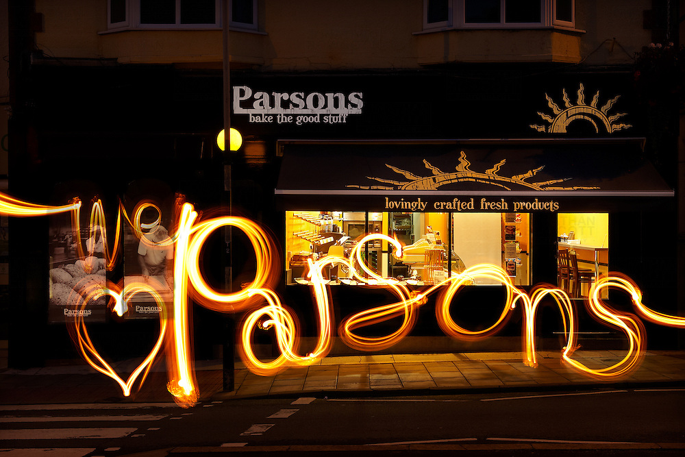 Night shot, with light writing, of the Parsons bakery store in Westbury on Trym Bristol
