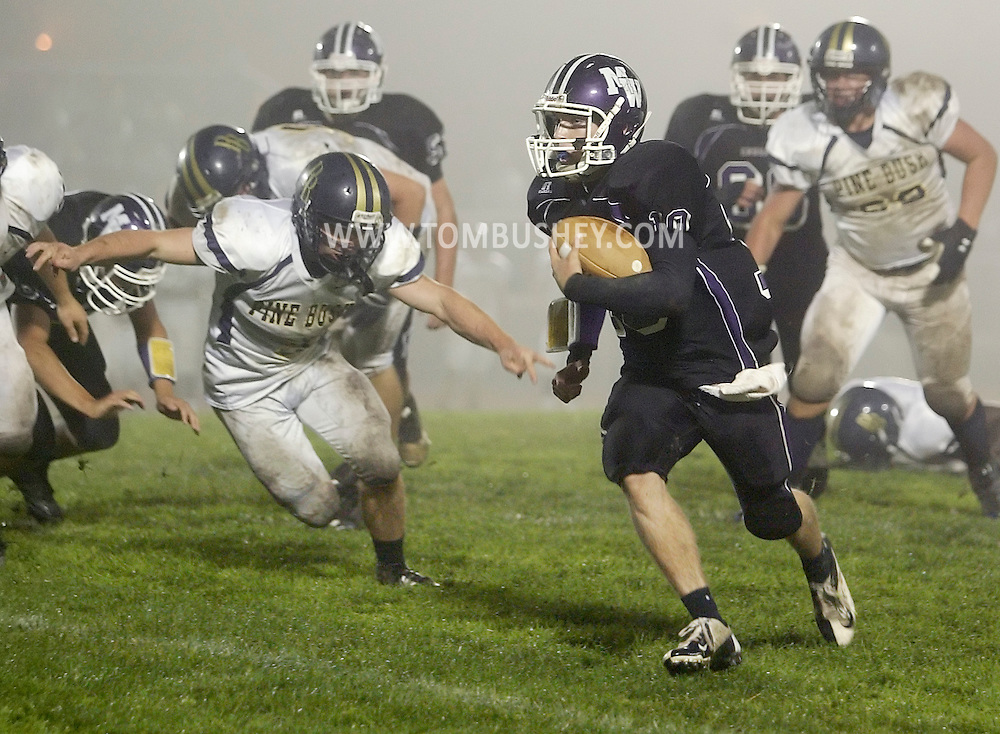Monroe-Woodbury quarterback Kevin Carr breaks through the Pine Bush defense during a game in Central Valley on Friday, Sept. 28, 2012.