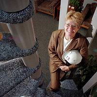 Beth Pancoe, President of SDI Construction Inc.poses for a photo in her office.