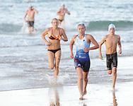 2010 Noosa Triathlon Festival.ENDURA Noosa Run Swim Run.Senior competitors emerge from the swim leg of the run swim run..27/10/2010.Noosa Main Beach, Noosa, Queensland, Australia.