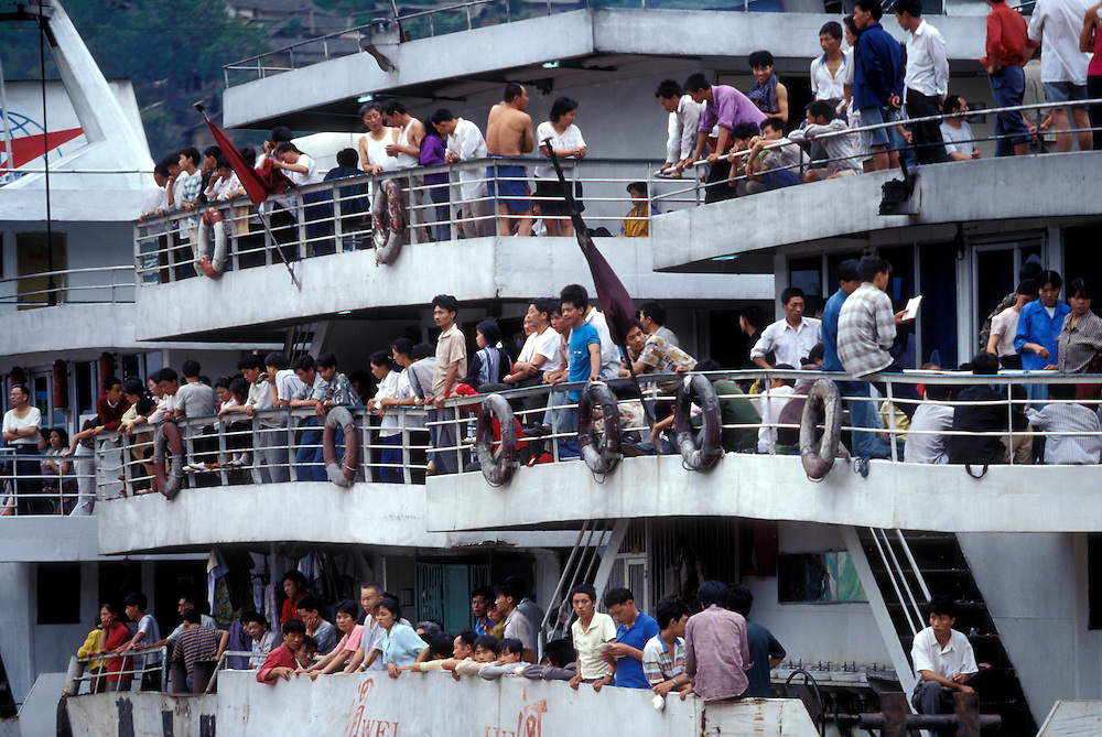 China, Sichuan Province, Wushan, Passengers crowd onto Yangtze River ferry above site of Three Gorges Dam