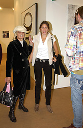 Left to right, Rock Roll figure ANITA PALLENBURG and STELLA SCHNABEL daughter of artist Julian Schnabel at a private view of the 2004 Frieze Art Fair - a major exhibition attended by most of the leading contempoary art dealers held in Regents Park, London on 14th October 2004.NON EXCLUSIVE - WORLD RIGHTS