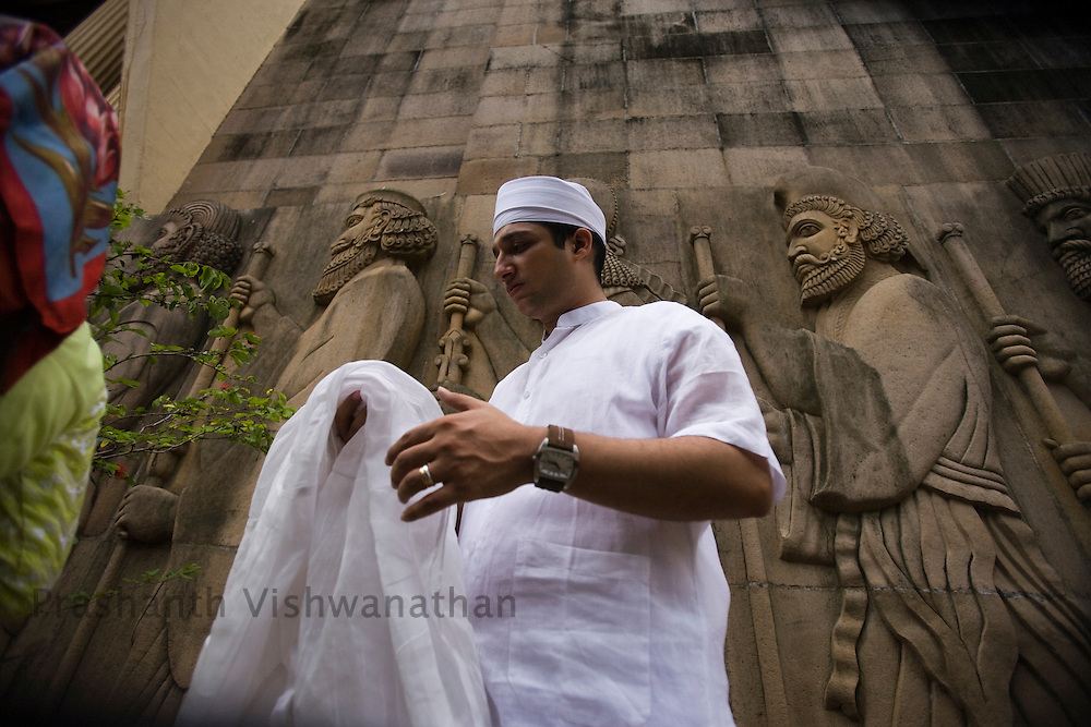 A Parsi youth reacts in his traditional Parsi attire  at the Kappawala Agiary, or Fire Temple, on Navroze, the Parsi new year, in Mumbai, India, Tuesday, Aug. 19, 2008. Parsis, also known as Zoroastrians, worship fire and are followers of the Bronze Age Persian prophet Zarathustra. According to estimates there are only 150,000 Zoroastrians in the world today and more than 80,000 live in India, mostly in Mumbai. Photographer:Prashanth Vishwanathan/Atlas Press