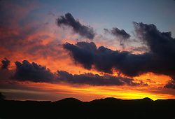 dramatic sunset over mountain range in Santa Fe, New Mexico