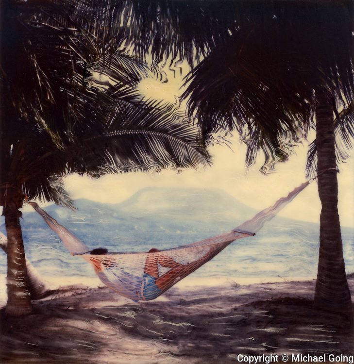 Altered Polaroid SX-70 photo Man in Hammock Banana Bay St Kitts BWI