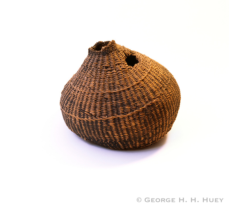 0603-7001 ~ Copyright:  George H. H. Huey ~ Historic Chumash Indian water bottle made from rushes.  California.  Interior is coated with asphaltum.  8 1/2 inches tall.