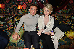 TOM DALEY and SOPHIE LEE at a party hosted by fashion website Farfetch to launch i.am + EPs headphones hosted by Will.i.am at Loulou's, 5 Hertford Street, London on 16th September 2016.