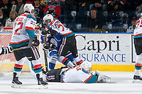 KELOWNA, CANADA - MARCH 11: Devante Stephens #21 of Kelowna Rockets checks Regan Nagy #24 of Victoria Royals at the net after a collision with Jackson Whistle #1 of Kelowna Rockets on March 11, 2015 at Prospera Place in Kelowna, British Columbia, Canada.  (Photo by Marissa Baecker/Shoot the Breeze)  *** Local Caption *** Devante Stephens; Jackson Whistle; Regan Nagy;