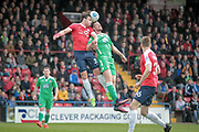 Sean Newton (York City) and Jordan White (Wrexham AFC) head the ball during the Vanarama National League match between York City and Wrexham FC at Bootham Crescent, York, England on 17 April 2017. Photo by Mark P Doherty.