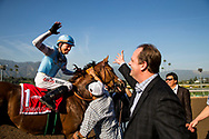 ARCADIA, CA - MARCH 11: Trainer, Doug O'Neill high-fives jockey Tyler Baze after winning theTriple Bend Stakes  aboard Denman's Call, at Santa Anita Park  on March 11, 2017 in Arcadia, California. (Photo by Alex Evers/Eclipse Sportswire/Getty Images)