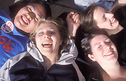 A group of friends lying down laughing