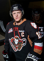 KELOWNA, CANADA, JANUARY 1: Cody Sylvester #16 of the Calgary Hitmen enters the ice as the Calgary Hitmen visit the Kelowna Rockets on January 1, 2012 at Prospera Place in Kelowna, British Columbia, Canada (Photo by Marissa Baecker/Getty Images) *** Local Caption ***