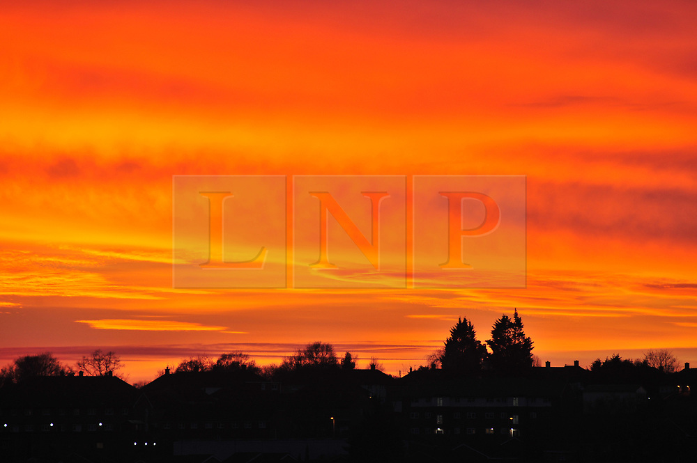 © Licensed to London News Pictures.19/12/2017.<br /> Orpington, UK.<br /> A fire red and yellow sunset tonight over Bromley and Orpington in South East London/Kent<br /> Photo credit: Grant Falvey/LNP