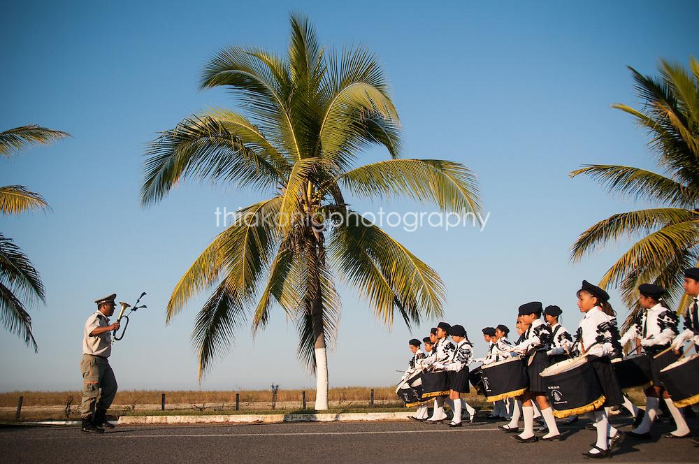 Children's parade with palm tree and ocean view, Barra de Navidad, Mexico