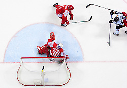 Felix Schutz of Germany (R) vs Mads Bodker and Frederik Andersen of Denmark during ice-hockey match between Denmark and Germany of Group E in Qualifying Round of IIHF 2011 World Championship Slovakia, on May 7, 2011 in Orange Arena, Bratislava, Slovakia. Denmark defeated Germany 4-3 after overtime and shootout. (Photo By Vid Ponikvar / Sportida.com)
