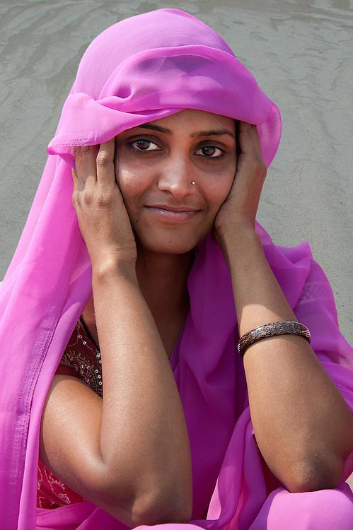 Portrait of a beautiful Indian young woman wearing a pink sari, Varanasi (India)