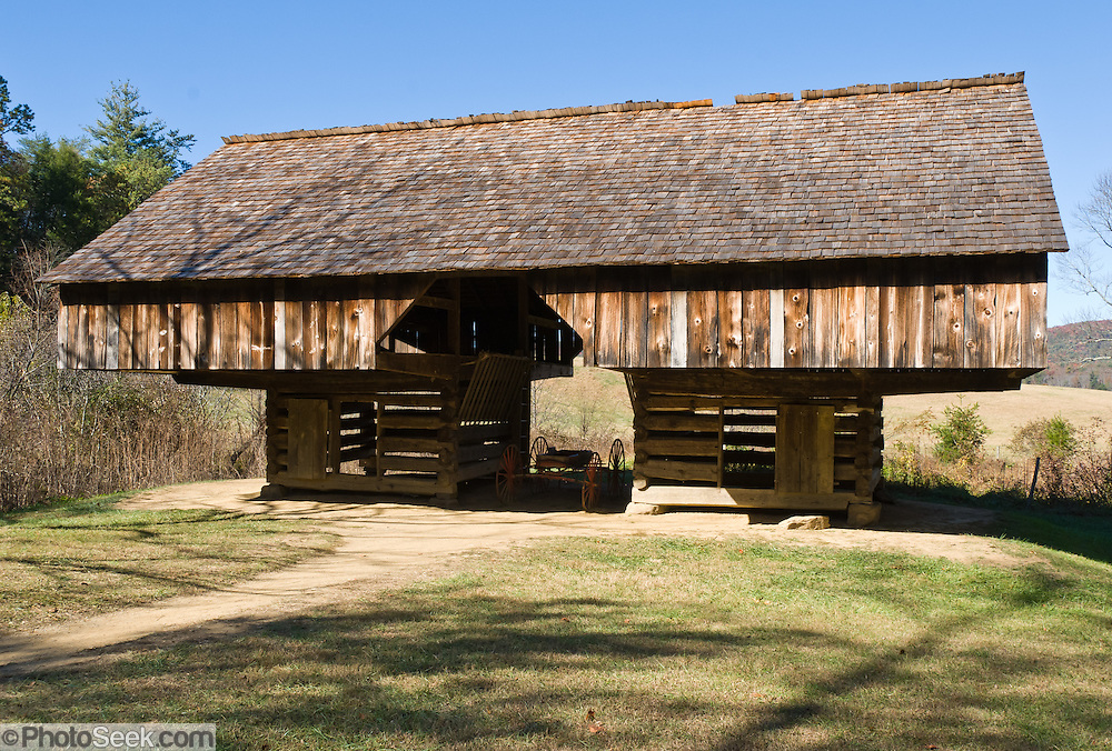 A replica of the original cantilever drive-through barn at Tipton Place, at Cades Cove, an isolated valley located in the East Tennessee section of Great Smoky Mountains National Park, USA. Cades Cove was once home to numerous settlers. Today Cades Cove is the most popular destination for visitors to the park, attracting over two million visitors a year, due to its well preserved homesteads, scenic mountain views, and abundant display of wildlife.