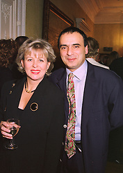 MISS DEBBIE HODGES and actor PETER POLYCARPOU, at a dinner in London on 14th January 1998.MEN 30
