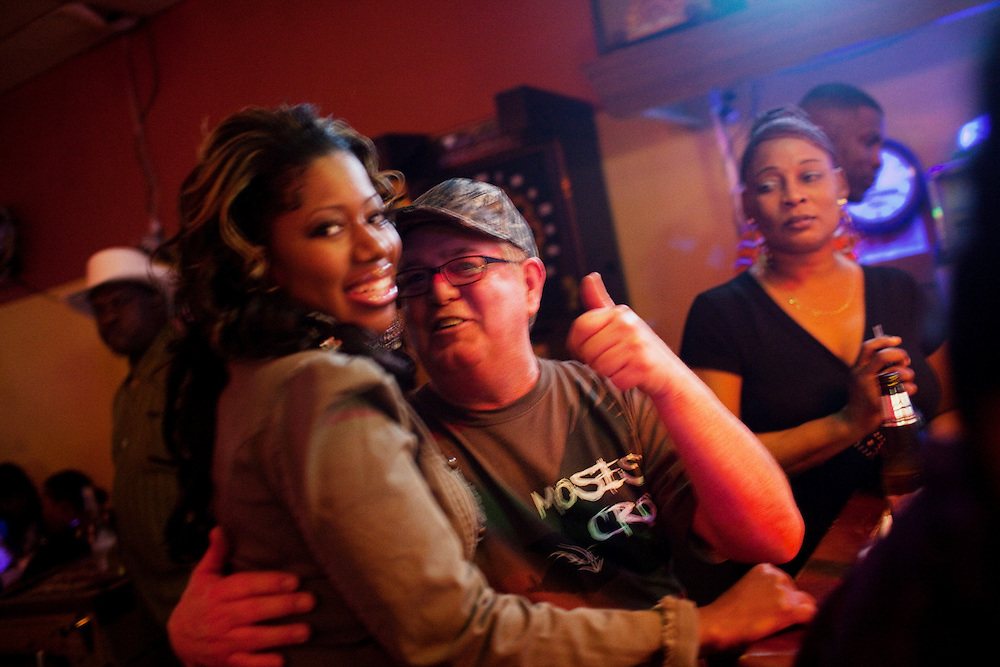 The owner of Joe's Place, carouses with women at a R&B night in Greenwood, Mississippi on February 17, 2011. Joe's Place is a bar just across the tracks from the Baptist Town neighborhood where people from different side of the tracks feel comfortable to mix.