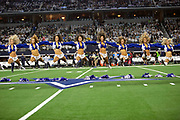 The Dallas Cowboys cheerleaders leap in the air and bounce of the turf as they perform a dance routine during pregame festivities before the NFL football NFC wild card playoff game against the Seattle Seahawks on Saturday, Jan. 5, 2019 in Arlington, Tex. The Cowboys won the game 24-22. (©Paul Anthony Spinelli)