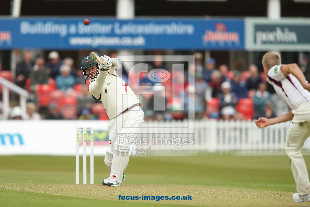 Clint McKay of Leicestershire County Cricket Club (left) hits the ball to the boundary for four from bowler Olly Stone of Northamptonshire County Cricket Club (right) during the LV County Championship Div Two match at Grace Road, Leicester<br /> Picture by Andy Kearns/Focus Images Ltd 0781 864 4264<br /> 27/04/2015