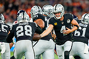 Derek Carr (QB) of the Oakland Raiders hands the ball off to Josh Jacobs (RB) of the Oakland Raiders during the International Series match between Oakland Raiders and Chicago Bears at Tottenham Hotspur Stadium, London, United Kingdom on 6 October 2019.