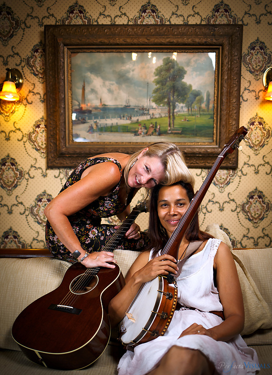 Singer/songwriter Laurelyn Dosset plays her guitar with fellow musician Rhiannon Giddens, as she plays her banjo in the historic Warfield House Bed & Breakfast in Elkins, West Virginia, Wednesday, August 5, 2015.The two are teaching at a music workshop at  the Augusta Heritage Center of Davis & Elkins College in Elkins, West Virginia.