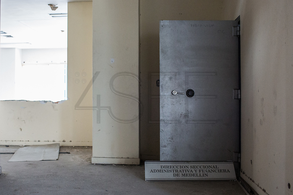"""2015/11/20 - Medellín, Colombia:  Pablo Escobar old safe which was bigger than many people's rooms,   Monaco building, Medellín. After Colombia's most famous drug lord death, people enter his former home and started to make holes on the walls and ceilings looking for hidden cash. Pablo Escobar once was named by Forbes magazine as the 7th richer man in the world. Tours focusing on the life and death of Pablo Escobar are becoming quite popular among international tourists that visit Medellín. In recent times more than 10 tour operators have started to give the tour, helped by the interest generated by Netflix """"Narcos"""" series. (Eduardo Leal)"""