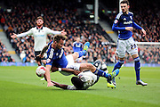 Cardiff City midfielder, Joe Ralls (8) getting fouled by Fulham striker, Moussa Dembele (25) during the Sky Bet Championship match between Fulham and Cardiff City at Craven Cottage, London, England on 9 April 2016. Photo by Matthew Redman.
