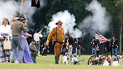 Photo by Gary Cosby Jr.  Civil War Reenactors converged on Point Mallard to stage the Battle for Decatur Saturday.  Chaos ensues as Union Troops advance on Confederate lines.