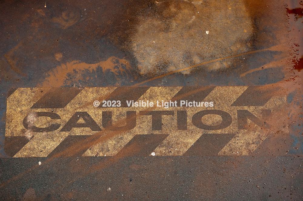 Caution Sign Painted on sidewalk