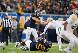Dec 3, 2016; Morgantown, WV, USA; West Virginia Mountaineers quarterback Skyler Howard (3) throws a pass during the first quarter against the Baylor Bears at Milan Puskar Stadium. Mandatory Credit: Ben Queen-USA TODAY Sports