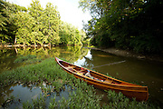Handmade wooden canoe on the banks of the Olentangy River in Central Ohio.