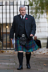 © Licensed to London News Pictures. 10/11/2019. London, UK. Ian Blackford, Leader of the Scottish National Party at Westminster walks through Downing Street wearing a kilt to attend the Remembrance Sunday Ceremony at the Cenotaph in Whitehall. Remembrance Sunday events are held across the country today as the UK remembers and honours those who have sacrificed themselves in two world wars and other conflicts. Photo credit: Vickie Flores/LNP