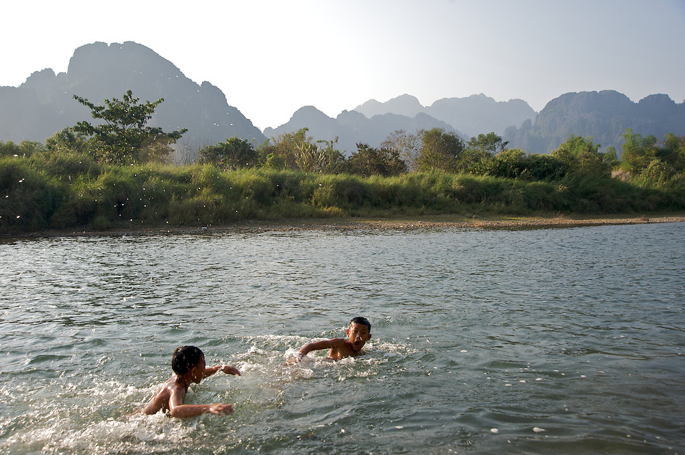 Boys play in the Nam Song River near the town of Vang Vieng, Laos.