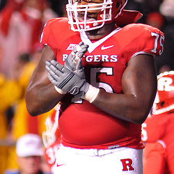 """Oct 16, 2009; Piscataway, NJ, USA; Rutgers offensive lineman Anthony Davis (75) signals his teammates to """"keep chopping"""" after a touchdown during second half NCAA football action in Pittsburgh's 24-17 victory over Rutgers at Rutgers Stadium."""