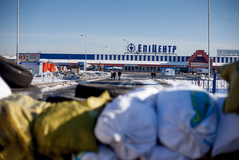 """View from the barrikades to the blocked building supplies store named """"Epicenter"""" in the city of Lviv, Ukraine."""